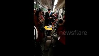 Boy does homework on carry-on folding table in subway carriage - Video