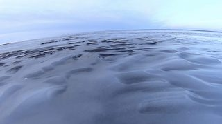 Catching perfect waves – Lake frozen in time - Video