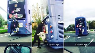 Shocking footage shows pair of lads jump on back of moving bus on busy roundabout