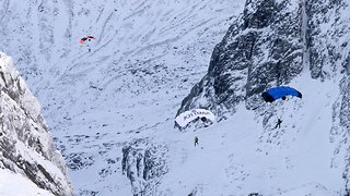 Nail-biting footage captures moment group of friends descend from peak of Ben Nevis in parachute