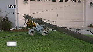 Power lines down across home's driveway in Lehigh Acres - Video