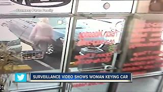 Surveillance video shows woman keying car - Video