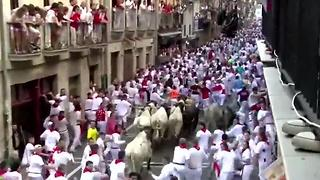 Participants gored during Running of the Bulls - Video