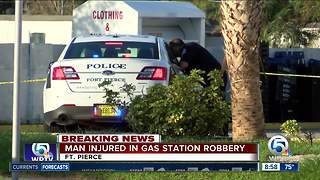 Man injured in gas station robbery - Video
