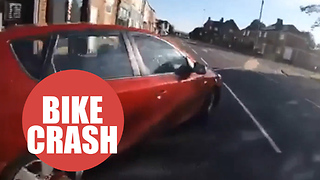 Cyclist nearly collides with a car after a reckless driver sharply pulls out - Video