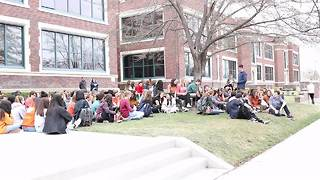 Students chant 'enough' during gun violence protest - Video