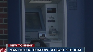 Man held at gunpoint at east side ATM