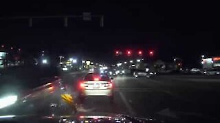 Careless driver projects road sign into cop car's windshield!
