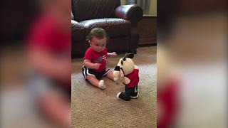 Funny Baby Boy Dances With His Dancing Toy