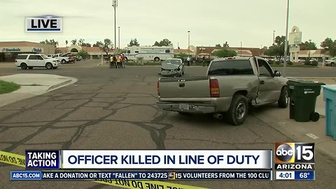Officer dies after being hit by vehicle in west Phoenix