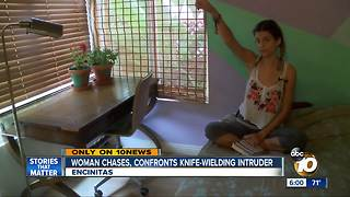 Woman confronts knife-wielding intruder