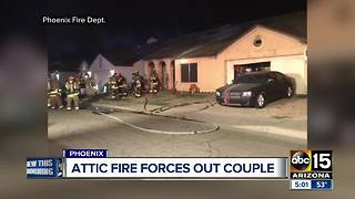 Attic fire forces out couple in Phoenix - Video