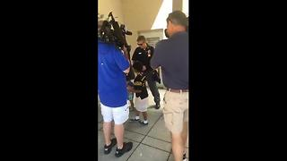 7-year-old hugs police - Video