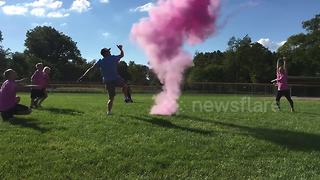 Family kick football to reveal baby's gender