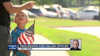 Community gathers along procession route for fallen MPD officer - Video