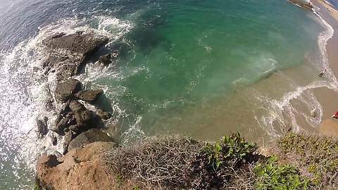 Daredevil Jumps Off Cliff Into Shallow Water From Dizzy Height