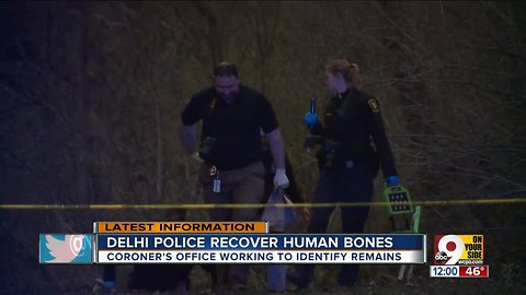 Crews search woods in Delhi Township for more human remains