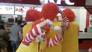 Men Dressed as Ronald McDonald Really Don't Like KFC - Video