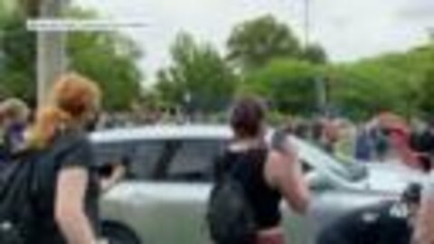 Video: Car drives through barricade at Lawrence protest