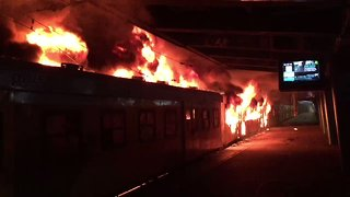 Angry Commuters Torch Trains at Cape Town Railway Station - Video