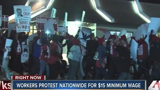 Workers protest for $15 minimum wage - Video