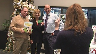 Gary Lezak gives Snowflake Contest winner prize
