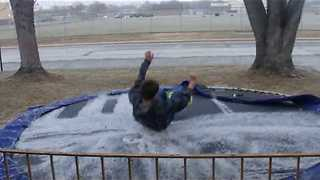Kid Jumping On Frozen Trampoline Makes A Glorious Presentation - Video