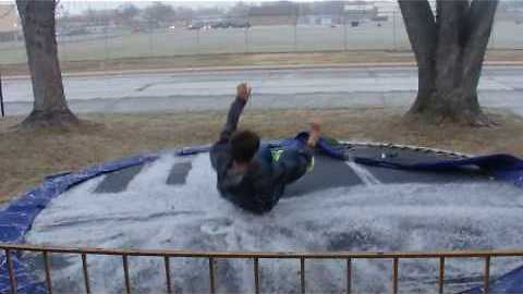 Kid jumps onto trampoline of ice - you'll watch this twice!