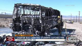 Charter bus carrying Henderson students catches fire - Video