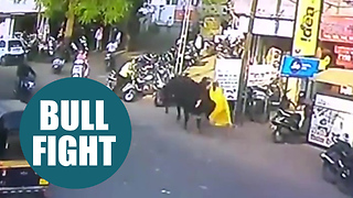 Bizarre moment a woman was out shopping on a busy street when she was charged by a BULL - Video