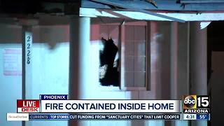 Fire contained inside home in Phoenix - Video