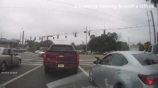 Shootout caught on video at Florida red light - Video