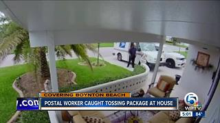 Security camera catches postal worker throwing package - Video