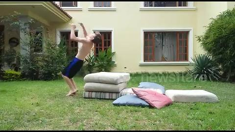 Boy lands on his face in hilarious backflip fail