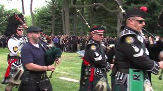Bagpipes play at the end of Lt. Aaron Allan's funeral - Video