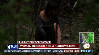 Woman rescued after being caught in dangerous storm water