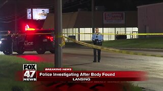 Police investigating after man's body found in Lansing