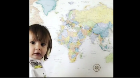 Smart toddler correctly points to various locations on map