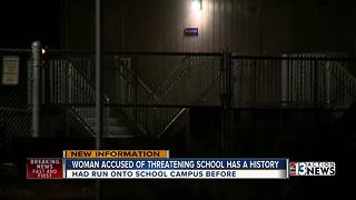 Woman accused of threatening school with ax has a history - Video