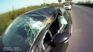 Flying tyre comes out of nowhere and smashes into windscreen