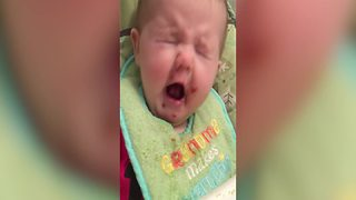 A Baby Girl Makes Silly Faces to Make Her Mom Laugh - Video