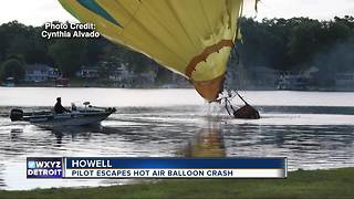 Pilot escapes hot air balloon crash - Video