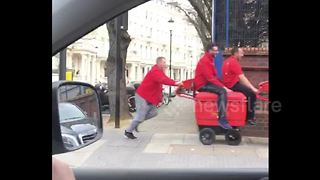 Special delivery service! London postmen filmed pushing colleagues on trolley - Video
