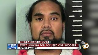 SWAT looking for accused cop shooter