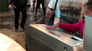 Commuters Walk Through Flooded Metro Station in Paris