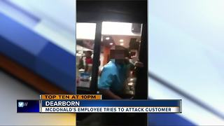 McDonald's employee tries to attack customer - Video