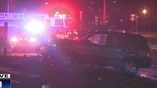 Power lines in road after driver crashes in Livonia - Video