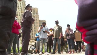 Police Commissioner Byron Lockwood meets protesters in Niagara Square