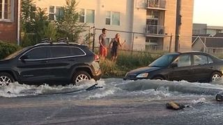 Water Main Break Floods Denver Road