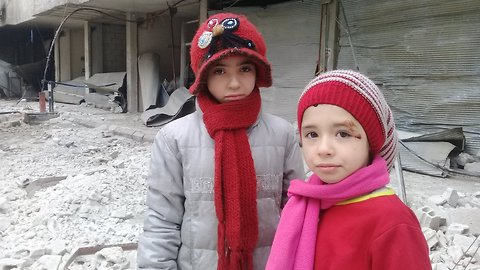 Day After House Damaged, East Ghouta Children Tour Their Neighborhood